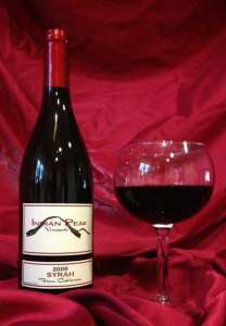 Syrah - 2009 Bottle and Glass of Wine from Indian Peak Vineyards of Manton, Ca. 96059.
